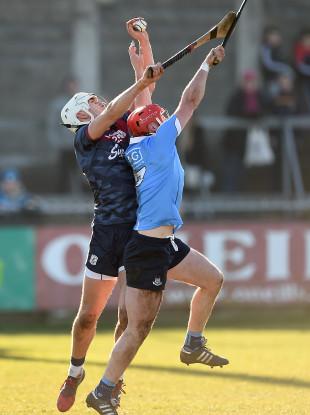 Galway's Jason Flynn in action against Dublin's Bill O'Carroll.