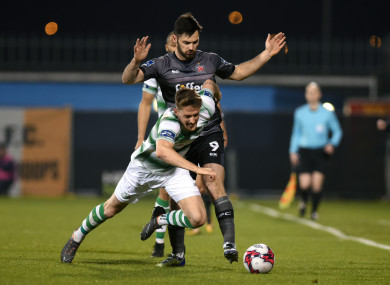 Dundalk's Pat Hoban and Lee Grace of Shamrock Rovers in action.