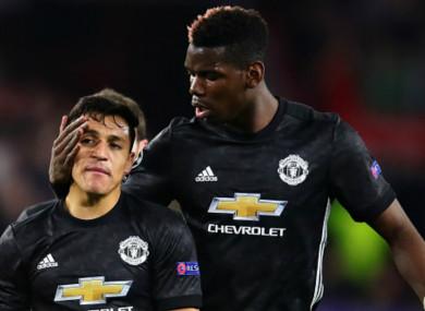 Paul Pogba and Manchester United team-mate Alexis Sanchez (L)
