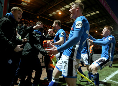 Davis and the Rochdale players celebrate their goal.