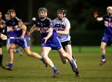 Niall O'Brien in action for DIT with UCD's Tom Phelan following closely behind.