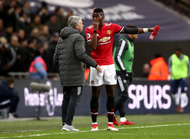 Mourinho giving Pogba instructions.