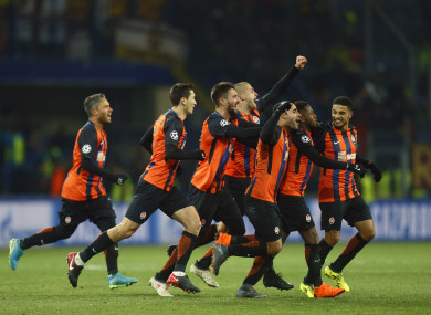 The Shakhtar players celebrate Fred's winner.