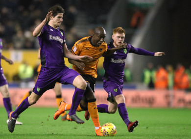 Wolverhampton Wanderers' Benik Afobe battles for the ball with Norwich City's Timm Klose.
