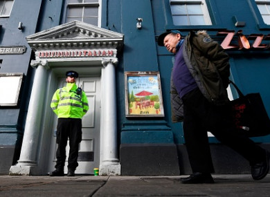 A poice officer stands guard outside a branch of the Italian chain restaurant Zizzi close to The Maltings shopping centre in Salisbury.