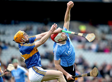 Dublin's Paddy Smyth catches under pressure from Cian Darcy of Tipperary.