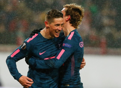Torres and Griezmann celebrate a goal.