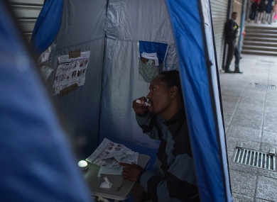 A man uses a HIV self-testing kit at the University of the Witwatersrand in Johannesburg
