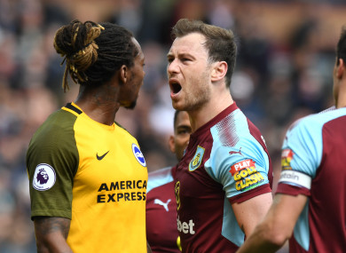 Bong and Burnley's Ashley Barnes exchange words during the game.
