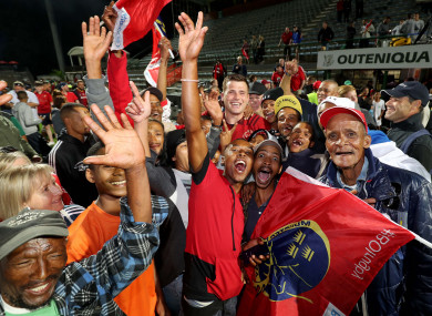 CJ Stander surrounded by both sets of fans after Munster's win on Saturday in George, South Africa.