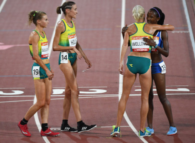 Lineo Chaka is greeted by the Australian athletes.
