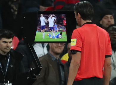 Referee Deniz Aytekin consults VAR before awarding Italy a penalty against England recently.