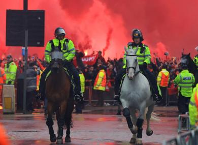 Officers on horseback outside the stadium before kick-off.