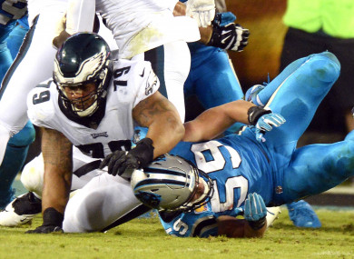 Brandon Brooks blocks Luke Kuechly.
