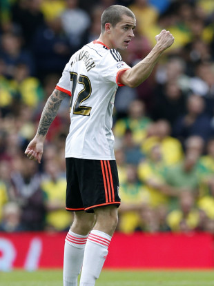 Kavanagh celebrates scoring a goal for Fulham at Craven Cottage in 2014.