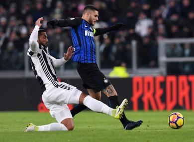 Inter Milan captain Mauro Icardi is tackled by Juventus defender Medhi Benatia.
