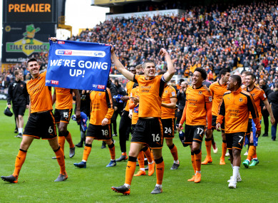 The Wolves players celebrate winning promotion to the top flight.