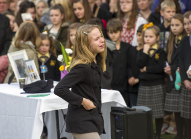 Relatives and friends gather for a memorial service for victims of MH17 plane crash.