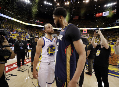 Golden State Warriors' Stephen Curry and New Orleans Pelicans' Anthony Davis after their game.