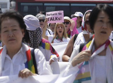 Activists march toward the Unification Bridge, which leads to Panmunjom in the Demilitarised Zone, South Korea,