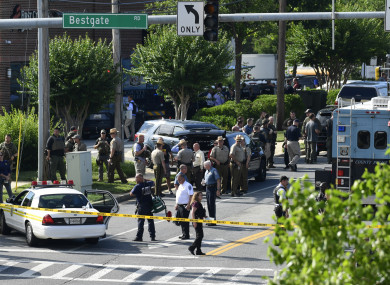 Police secure the scene of a shooting at an office building housing The Capital Gazette newspaper in Annapolis