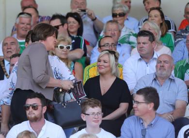 DUP Leader Arlene Foster walks past Sinn Fein Vice President Michelle O'Neill at the Ulster final.