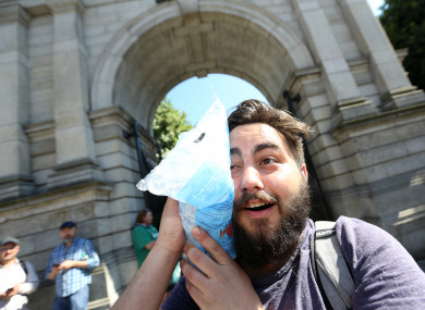 Benjamin Jourdan from France cools off using a bag of ice last month.