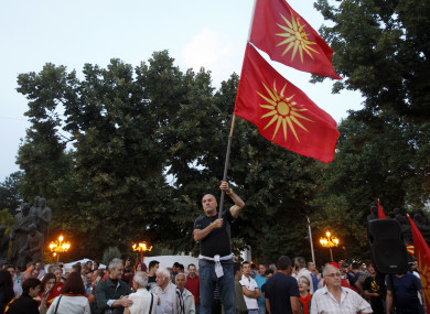 A man waves the former national flags during a protest in Skopje, Macedonia.