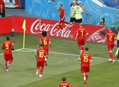 Belgium's Dries Mertens, top, celebrates after scoring the opening goal.
