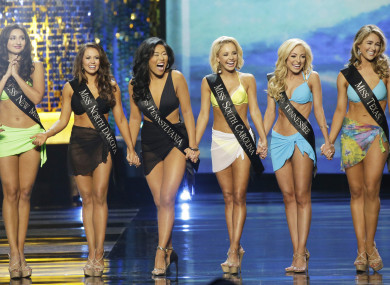 Contestants wearing swimsuits at the 97th annual 2018 Miss America Competition last year.
