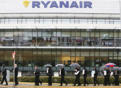 Pilots on strike in the rain outside Ryanair head office in Swords, Dublin