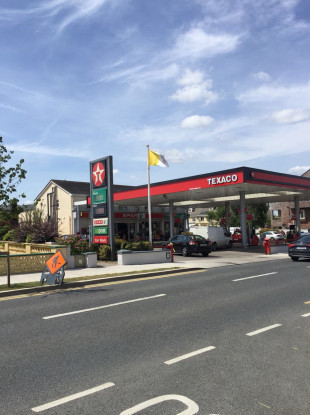 Texaco petrol in Newcastle is flying the Vatican flag.
