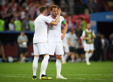 Kane is consoled by Phil Jones at full-time.