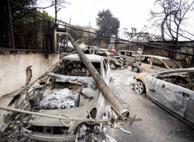 Burnt cars in the town of Mati