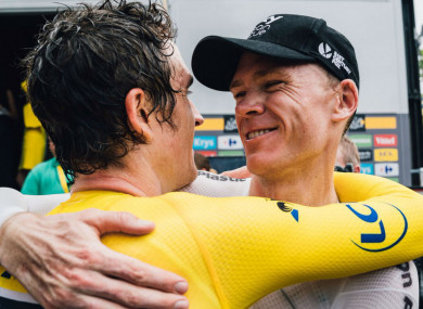 Geraint Thomas and Chris Froome embrace.