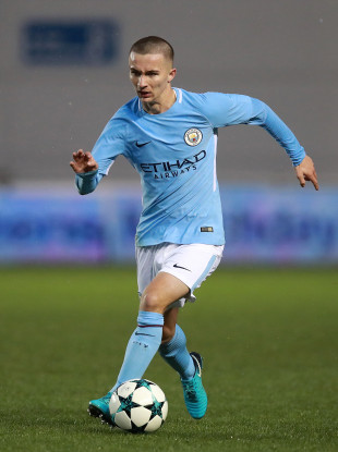 Young Irish defender included in Pep Guardiola's Man City squad for