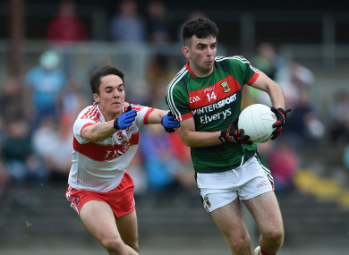 Conor McCluskey tackles Ross Egan.