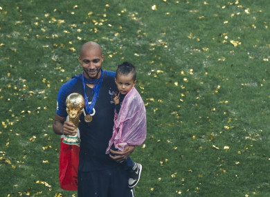 N'Zonzi holds the World Cup trophy and his child.