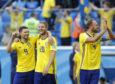 Sweden's players celebrate their team victory over Switzerland.
