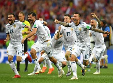Russian players celebrate following Igor Akinfeev's penalty save.