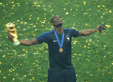 Paul Pogba celebrates with the World Cup trophy.