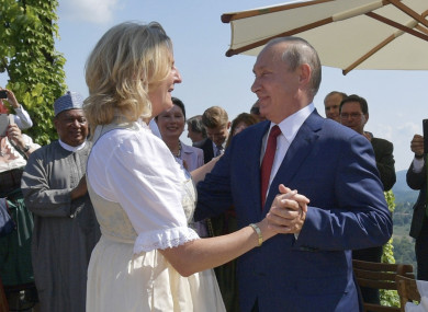 Russian President Vladimir Putin dances Austrian Foreign Minister Karin Kneissl at her wedding.