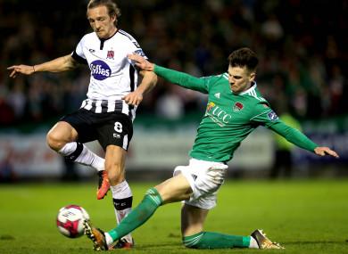 Cork City's Danny Kane tackles John Mountney of Dundalk during their Premier Division game in April.