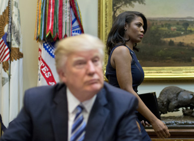 White House Director of communications for the Office of Public Liaison Omarosa Manigault, right, walks past President Donald Trump