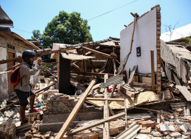 A collapsed house after an earthquake hit on Sunday in North Lombok, Indonesia