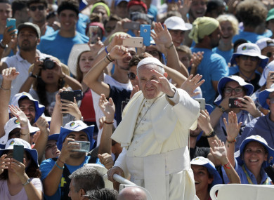 Pope Francis meeting youths in St. Peter's Square at the Vatican.