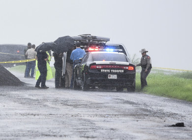 Law enforcement at the scene where the fourth body was found.