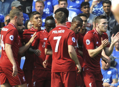 Liverpool's Sadio Mane, centre, celebrates after scoring his side's first goal with team-mates.
