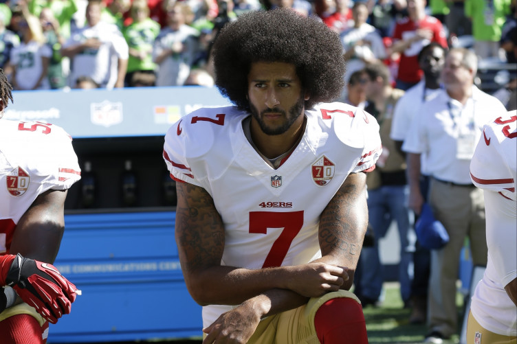 dc34200a1 Colin Kaepernick s Nike deal prompts flurry of debate and drop in stock  market