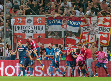 The Red Star players celebrate a goal at Salzburg's Red Bull Arena.